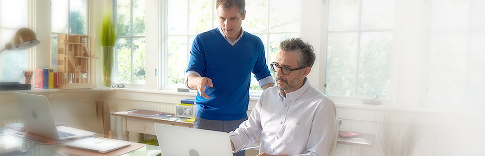 Image of two men looking at a computer monitor. Learn what patients should expect when taking SPRYCEL for the treatment of chronic myeloid leukemia